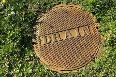 a rusty storm drain cover